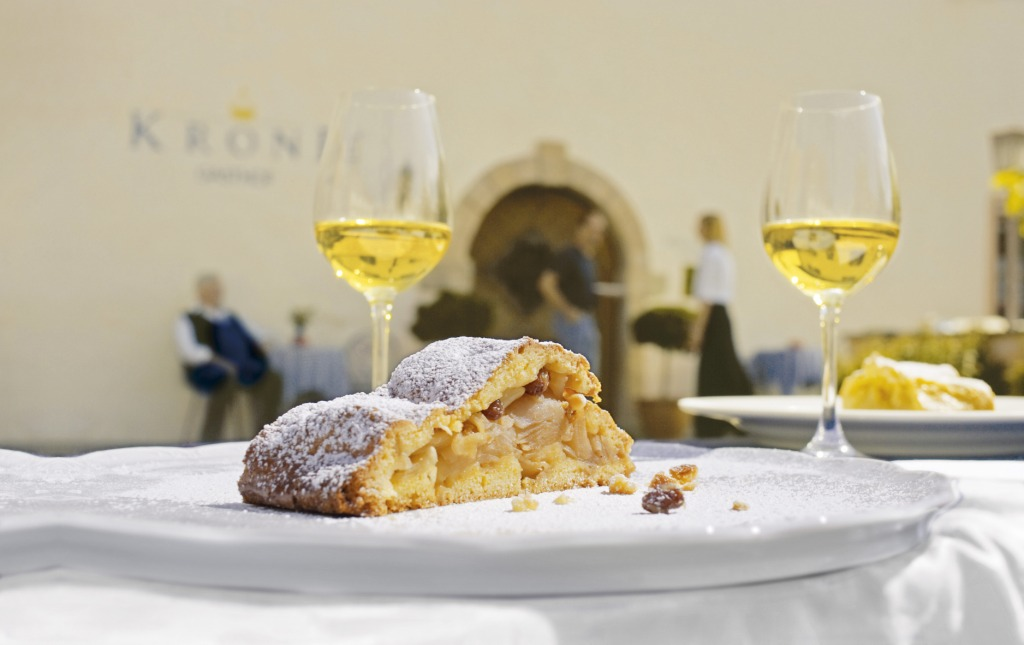 In South Tyrol, apple strudel is traditionally made with short pastry or crust pastry ? served with a glass of natural sweet white wine.