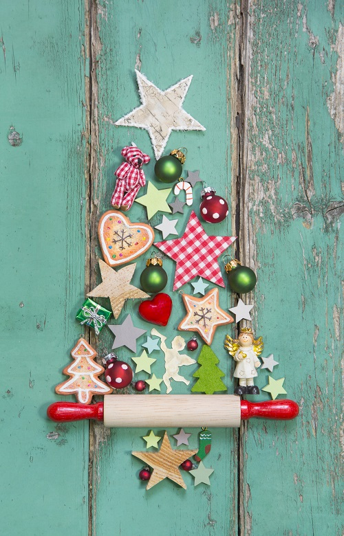 Christmas decoration on a green wooden background as a christmas