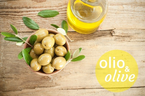 Olives on rustic table in a bowl
